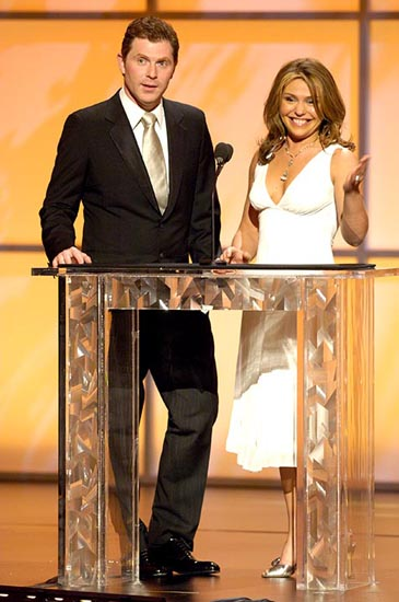 Here's a picture of Rachael Ray, sexy as ever, wearing a white evening gown.